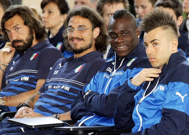 Italy's players, from left, Andrea Pirlo, Osvaldo, Mario Balotelli, and Stephan El Shaarawy attend a press conference by Italy coach Cesare Prandelli at the national team's Coverciano training complex in Florence, Italy, Tuesday, April 15, 2014, where 42 players were called up for World Cup fitness tests. (AP Photo/Fabrizio Giovannozzi)