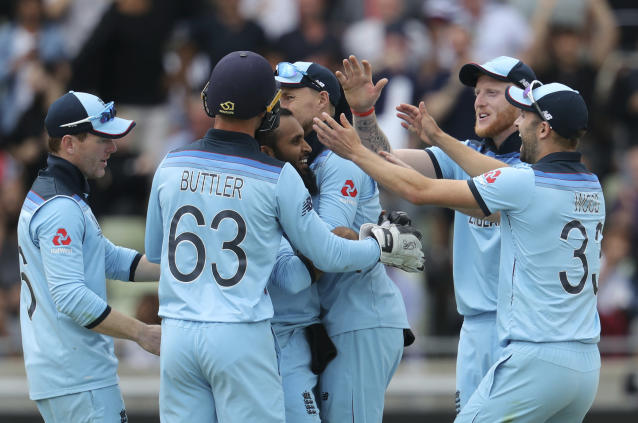 England's bowler Adil Rashid, middle, celebrates with teammates after dismissing Australia's Pat Cummins for 6 runs during the Cricket World Cup semi-final match between Australia and England at Edgbaston in Birmingham, England, Thursday, July 11, 2019. (AP Photo/Rui Vieira)