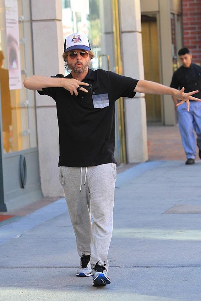 <p>Work it! The comedian had some fun with the paparazzi, strutting his stuff through Beverly Hills like he was on a catwalk. (Photo: Yellow Mamba/BackGrid) </p>