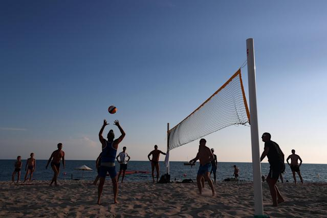 Soccer Football - World Cup - Sochi, Russia - June 17, 2018 General view of people playing beach volleyball in Sochi REUTERS/Hannah McKay