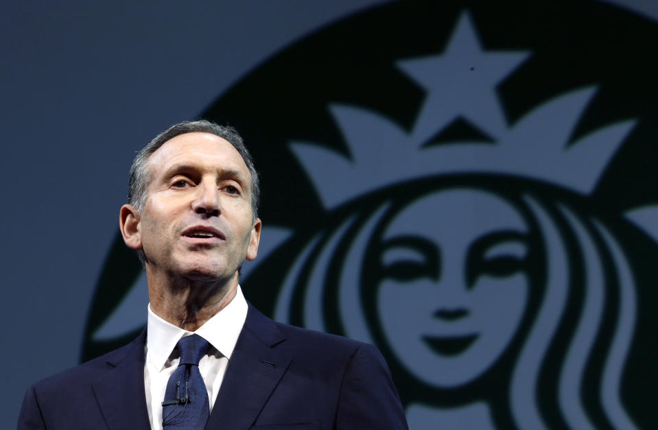 """FILE - In this March 20, 2013 file photo, Starbucks CEO Howard Schultz speaks at the company's annual shareholders meeting, in Seattle, Wash. From Wednesday, Oct. 9, 2013, to Friday, Oct. 11, 2013, the coffee chain is offering a free tall brewed coffee to any customer in the U.S. who buys another person a beverage at Starbucks. The offer is a way to help fellow citizens """"support and connect with one another, even as we wait for our elected officials to do the same for our country,"""" Schultz said in a memo to staff on Tuesday. (AP Photo/Ted S. Warren, File)"""