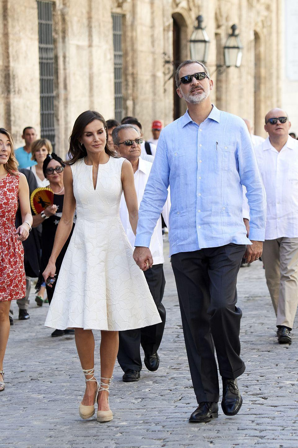 <p>More so even than her fellow royals—save, perhaps, for the Duchess of Cambridge—Spain's Queen Letizia has made espadrilles a staple of her wardrobe. Here, she matches a nude pair with a white A-line dress for a working trip to Cuba. </p>