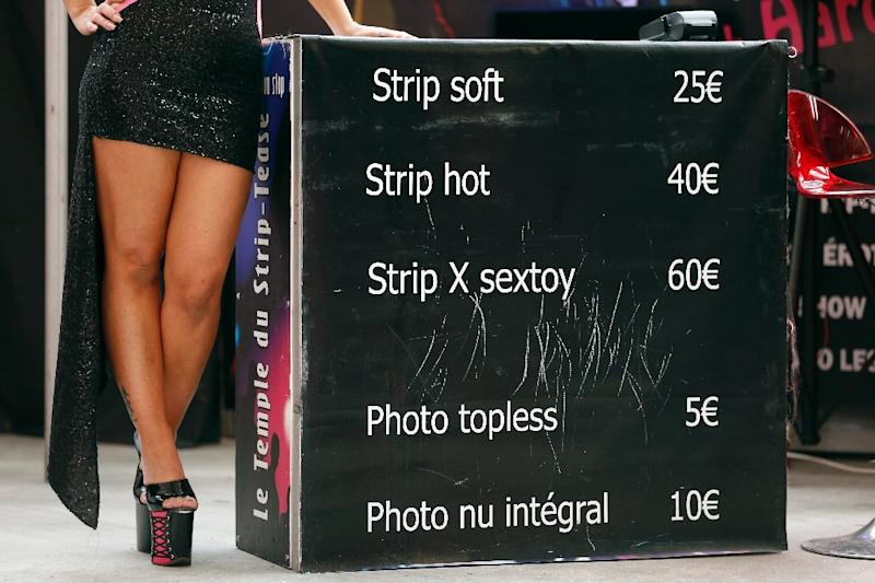 The hiring of strippers at funerals is a grave offence, say Chinese authorities (AFP Photo/Valery Hache)