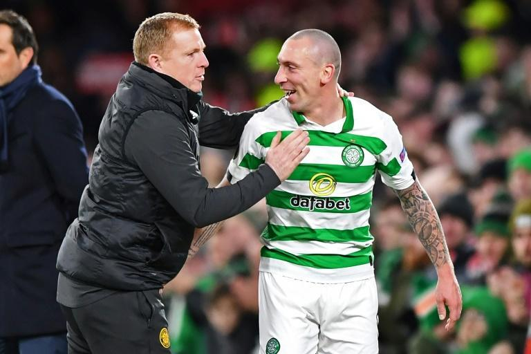 Captain fantastic: Scott Brown (right) saved Celtic with a late winner against Hamilton (AFP Photo/ANDY BUCHANAN)
