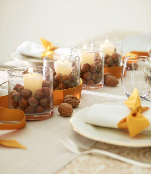 <p>Basic votive holders instantly look festive once they're filled with unshelled walnuts, chestnuts, or acorns.</p>