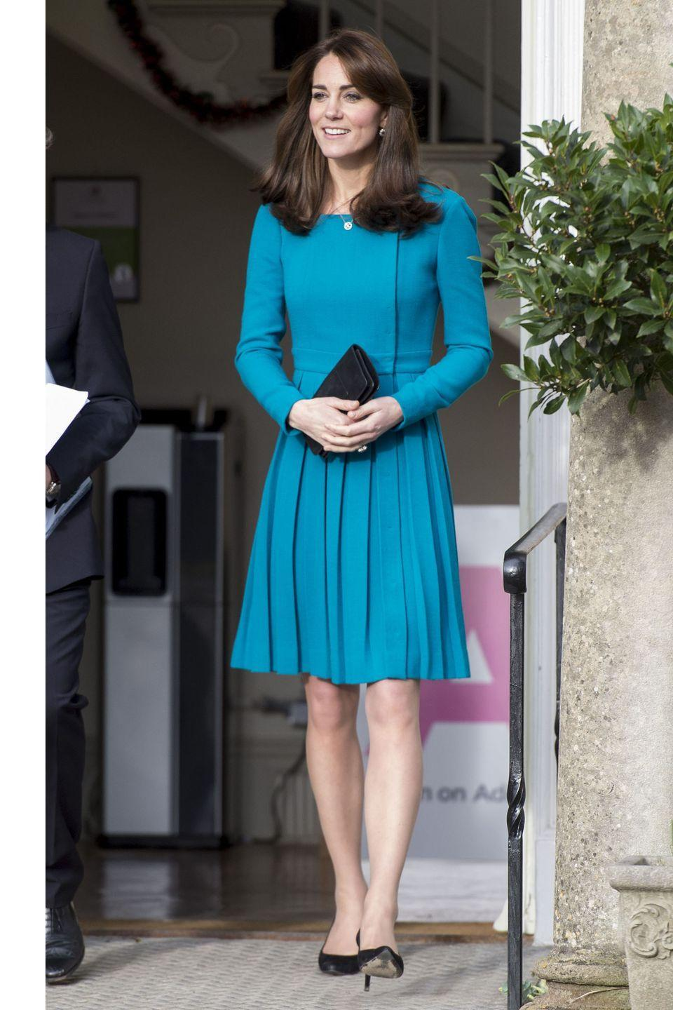 <p>Wearing a bright blue pleated Emilia Wickstead dress at the Action to Addiction event. </p>