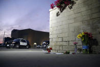 Flowers are placed in front of Saugus High School in the aftermath of a shooting on Thursday, Nov. 14, 2019, in Santa Clarita, Calif. (AP Photo/Marcio Jose Sanchez)