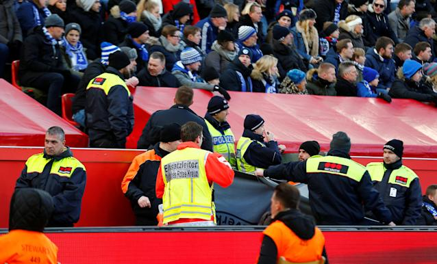 Soccer Football - Bundesliga - Bayer Leverkusen vs Schalke 04 - BayArena, Leverkusen, Germany - February 25, 2018 Medical staff in the stadium attend to a Schalke fan REUTERS/Thilo Schmuelgen DFL RULES TO LIMIT THE ONLINE USAGE DURING MATCH TIME TO 15 PICTURES PER GAME. IMAGE SEQUENCES TO SIMULATE VIDEO IS NOT ALLOWED AT ANY TIME. FOR FURTHER QUERIES PLEASE CONTACT DFL DIRECTLY AT + 49 69 650050