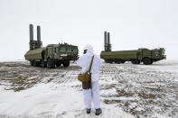 An officer speaks on walkie-talkie as the Bastion anti-ship missile systems take positions on the Alexandra Land island near Nagurskoye, Russia, Monday, May 17, 2021. Bristling with missiles and radar, Russia's northernmost military base projects the country's power and influence across the Arctic from a remote, desolate island amid an intensifying international competition for the region's vast resources. Russia's northernmost military outpost sits on the 80th parallel North, projecting power over wide swathes of Arctic amid an intensifying international rivalry over the polar region's vast resources. (AP Photo/Alexander Zemlianichenko)