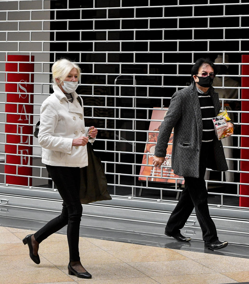 Shoppers walk in front of a closed store in the Czech Republic. Source: AP
