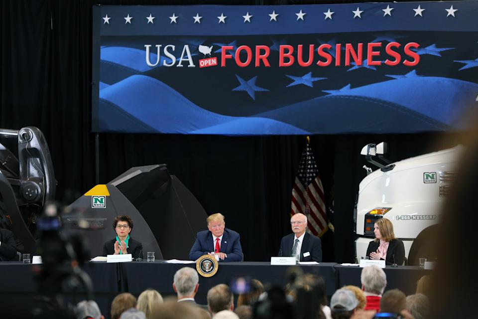 BURNSVILLE, MN - APRIL 15: (L-R) United States Treasurer Jovita Carranza, U.S. President Donald Trump and business owner Bob Nuss attend at a roundtable on the economy and tax reform at Nuss Trucking and Equipment on April 15, 2019 in Burnsville, Minnesota. At the special Tax Day roundtable Trump gave a defense of his 2017 tax cuts.(Photo by Adam Bettcher/Getty Images)