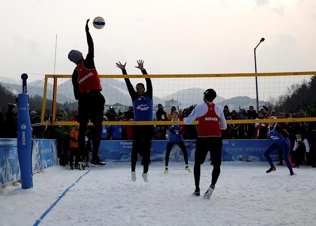 Pyeongchang 2018 Winter Olympics - Pyeongchang - South Korea – February 14, 2018. Players are seen in action during an event promoting the Snow Volleyball hosted by the International Volleyball Federation (FIVB) and European Volleyball Confederation (CEV). REUTERS/Kim Hong-Ji