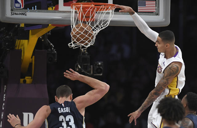 Kyle Kuzma, right, dunks on Grizzlies center Marc Gasol during Sunday's Lakers win. (AP)