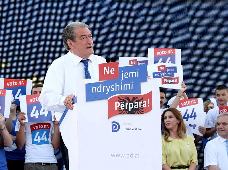 Albania's Conservative Prime Minister Sali Berisha, 68, who is seeking a third term in office, speaks at a rally in Tirana, Thursday, June 13, 2013. The general election taking place Sunday, June 23, 2013 is considered a test for the Balkan country to shed its post-Communist legacy of troubled popular votes, as it seeks closer ties and eventual membership in the European Union. Conservative Sali Berisha, is seeking a third term and will speak at his Democratic Party's main election rally Friday in the capital Tirana. (AP Photo/Hektor Pustina)