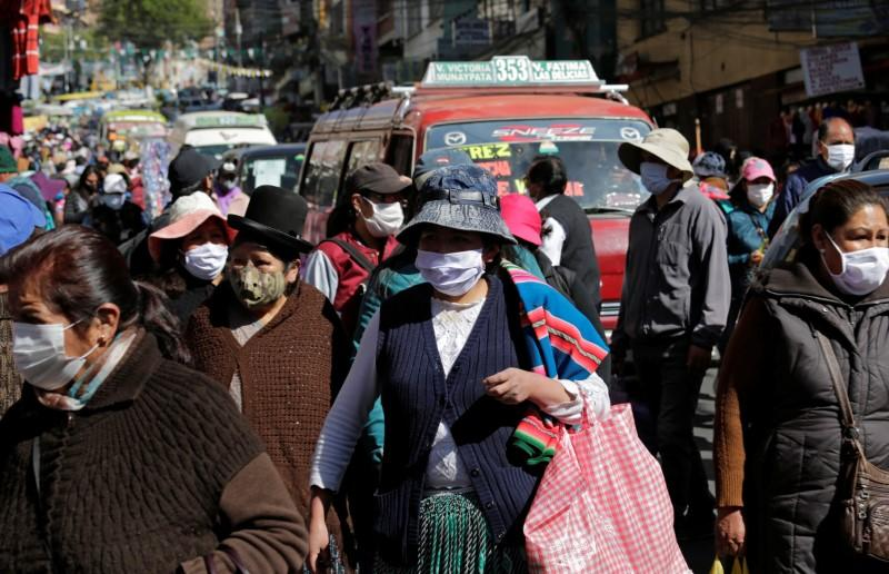 People wearing face masks are seen on the first day of eased coronavirus disease (COVID-19) restrictions in La Paz