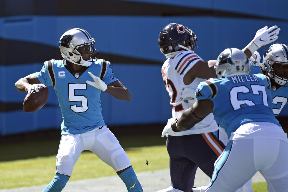 Carolina Panthers quarterback Teddy Bridgewater (5) looks to pass against the Chicago Bears during the first half of an NFL football game in Charlotte, N.C., Sunday, Oct. 18, 2020. (AP Photo/Mike McCarn)