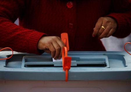 A woman cast her vote during the parliamentary and provincial elections in Thimi, Nepal December 7, 2017. REUTERS/Navesh Chitrakar
