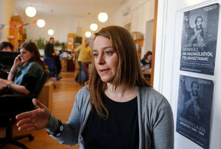 Marta Pardavi, co-chair of the asylum rights group Helsinki Committee, gestures during an interview in the group's headquarters in Budapest, Hungary, February 13, 2017. REUTERS/Laszlo Balogh