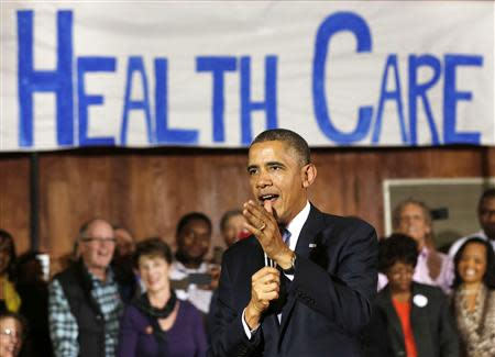 U.S. President Barack Obama speaks about Affordable Health Care to volunteers at the Temple Emanu-El in Dallas
