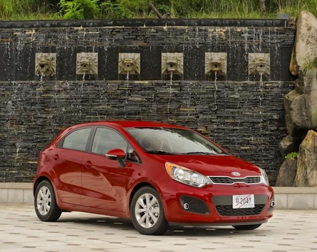 """<b><a href=""""http://autos.yahoo.com/kia/rio-5-door/"""" data-ylk=""""slk:Kia Rio5"""" class=""""link rapid-noclick-resp"""">Kia Rio5</a></b><br>MSRP: $14,900<br>MPG: 28 City / 36 Hwy<br><br>The Kia Rio is a peppy, fun ride that makes you feel like a Californian even if you're on the back roads of the Northeast. The tiger snout grill has an attractive pucker, and the new vehicle, unveiled at the 2011 New York Auto Show, has ISG (idle-stop-go) technology, the """"start-stop"""" engine shut-down mechanism to save gas for when the car is idling. It has excellent manueverability and feels just that much easier to slip into a tight parking spot."""