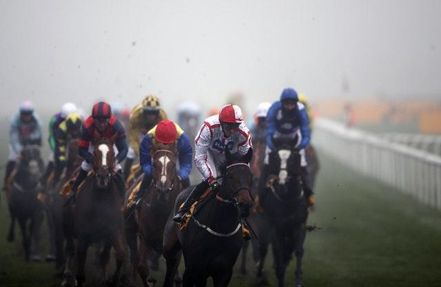 On To Victory, ridden by James Doyle, wins the Betfair November Handicap at a foggy Doncaster