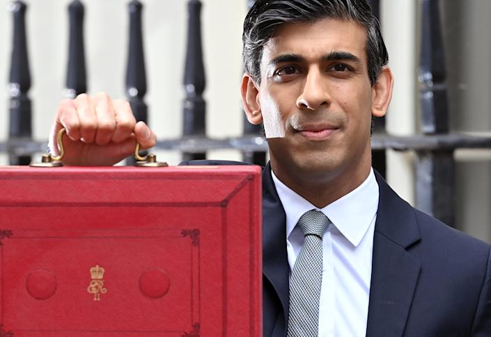 Chancellor of the exchequer, Rishi Sunak stands with the Budget Box outside 11 Downing Street ahead the budget on 3 March in London, England. Photo: Karwai Tang/Getty Images