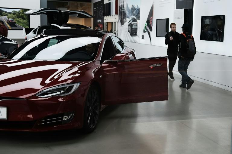 Elon Musk faces pressure over ramping up production of Teslas to meet consumer demand