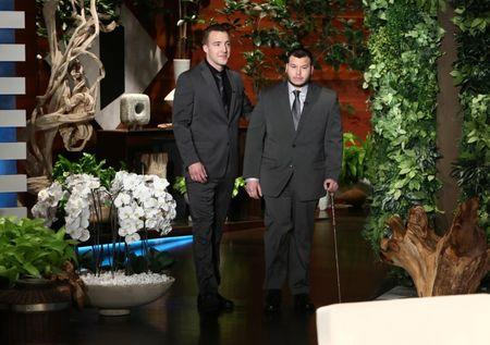 "Stephen Schuck and security guard Jesus Campos of the Mandalay Bay Resort and Casino in Las Vegas, pose during the taping of  ""The Ellen DeGeneres Show"" in Burbank, California in this photo released October 18, 2017.   Michael Rozman/Warner Bros./Handout via REUTERS"