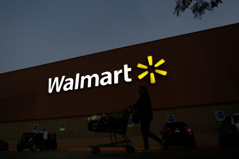Shopper pushes a cart outside a Walmart store in Monterrey