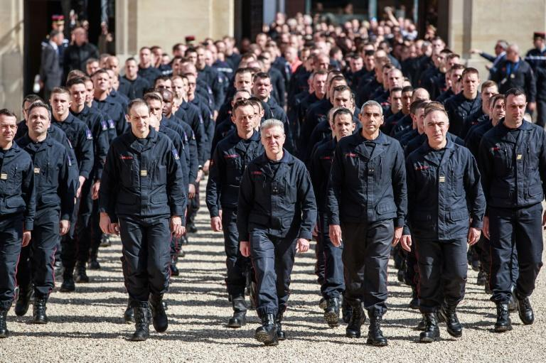 Firefighters arriving at the Elysee Palace to meet French President Emmanuel Macron