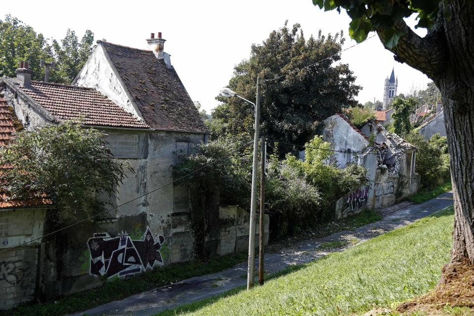 Abandoned houses marked with graffiti in the ghost town of Goussainville-Vieux Pays, just 12 miles from Paris. (Reuters)