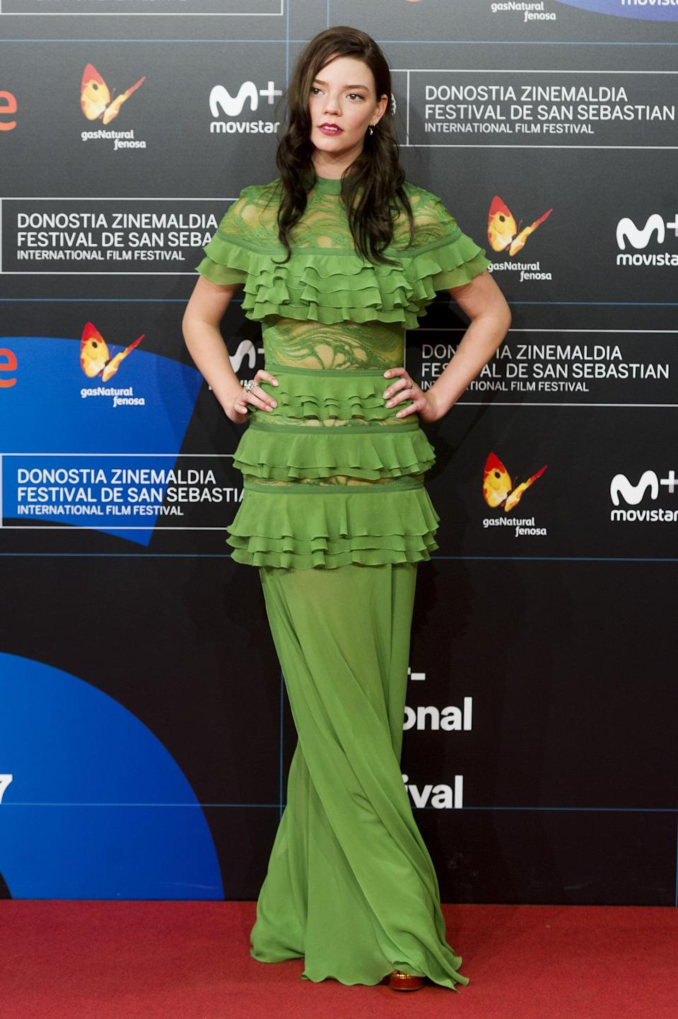 <p>Anya wore a ruffled Elie Saab gown in green.</p>
