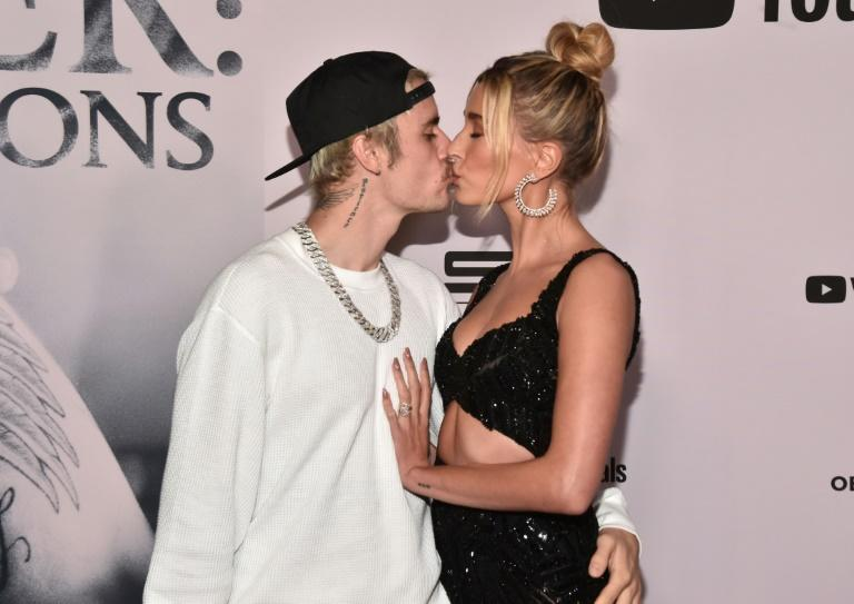 Justin Bieber has credited his wife Hailey Baldwin with turning around his life as he struggled under the weight of fame (AFP Photo/Alberto E. Rodriguez)
