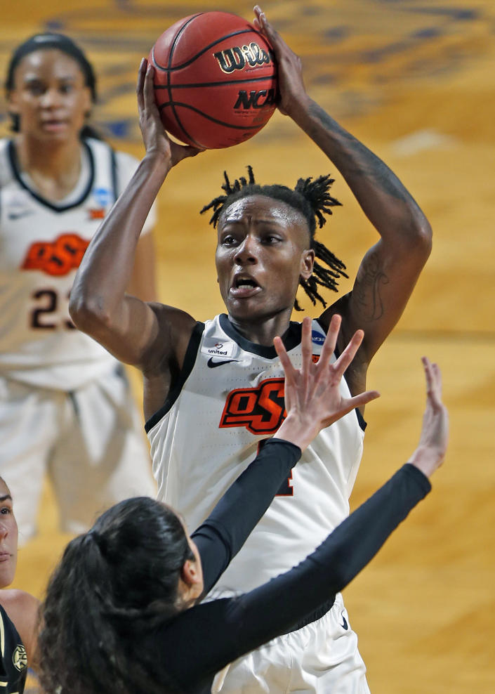 Oklahoma State forward Natasha Mack(4) shoots a basket over Wake Forest forward Christina Mora during the first half of a college basketball game in the first round of the women's NCAA tournament at the Greehey Arena in San Antonio, Texas, Sunday, March 21, 2021. (AP Photo/Ronald Cortes)