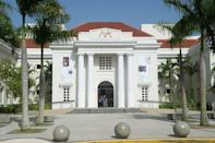 """<p><strong>Start with the backstory. What's the history here?</strong><br> Once a hospital, the Museo de Arte de Puerto Rico was restored and given new life in 1995. The grand building houses the work of the island's artists dating from the 17th century to the present day. The museum, located in the Santurce neighborhood, is widely considered a San Juan institution.</p> <p><strong>What can we expect to see?</strong><br> The permanent collection includes more than 1,000 works ranging from painting to sculpture to installations. All celebrate Puerto Rican culture.</p> <p><strong>Any temporary exhibitions we should check out, too?</strong><br> Rotating exhibitions, often with a political undercurrent, are part of the appeal. The exchange project <em>Repatriation,</em> for example, showcased the work of Puerto Rican artists in <a href=""""https://www.cntraveler.com/destinations/chicago?mbid=synd_yahoo_rss"""" rel=""""nofollow noopener"""" target=""""_blank"""" data-ylk=""""slk:Chicago"""" class=""""link rapid-noclick-resp"""">Chicago</a>.</p> <p><strong>Is there often much of a crowd?</strong><br> This museum usually is not too crowded and attracts culture-vultures looking for a reprieve from the beach.</p> <p><strong>How easy is it to get around—especially for visitors with limited mobility?</strong><br> The museum is easy to navigate; there are maps, air conditioning, and places to sit. There are guided tours daily, as well,The entirety of the building is wheelchair accessible; the organization has collaborated with local agencies to increase accessibility for myriad disabilities.</p> <p><strong>Gift shop: obligatory, inspiring—or skip it?</strong><br> The gift shop works to support local artisans, making it a good destination for souvenirs.</p> <p><strong>If we're tight on time, what should we prioritize?</strong><br> It's absolutely possible to see the best of this museum quickly. Hit Carlos Dávila-Rinaldi's <em>Gringomatic: No One Can Wash Away That Plantain Stain</em>; Marta Mabel Pérez's work"""