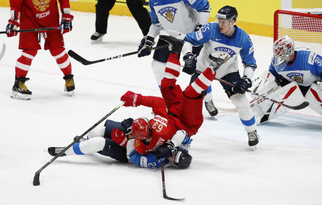 Russia's Yevgeni Dadonov, right, collides with Finland's Juhani Tyrvainen, left, during the Ice Hockey World Championships semifinal match between Russia and Finland at the Ondrej Nepela Arena in Bratislava, Slovakia, Saturday, May 25, 2019. (AP Photo/Petr David Josek)