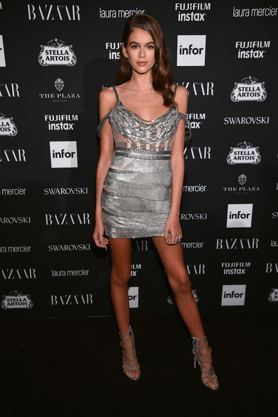 <p>Kaia rocked up to NYFW's most photographed party, wearing a spangly silver minidress.<br><i>[Photo: Getty]</i> </p>
