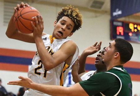 FILE PHOTO:    Dec 16, 2016; Las Vegas, NV, USA;  Clark Chargers forward Jalen Hill (21) pulls in a defensive rebound during a game against the Chino Hills Huskies on the second day of the Tarkanian Classic at Bishop Gorman High School.  Stephen R. Sylvanie-USA TODAY Sports/File Photo
