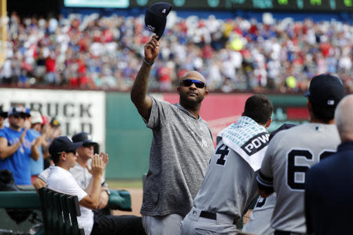 New York Yankees' CC Sabathia acknowledges cheers from fans after he was celebrated by the Texas Rangers in the second inning of a baseball game in Arlington, Texas, Sunday, Sept. 29, 2019. (AP Photo/Tony Gutierrez)