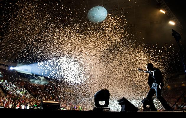Confetti sprays on the crowd in a rousing end to the concert. (Photo courtesy of Running Into The Sun)