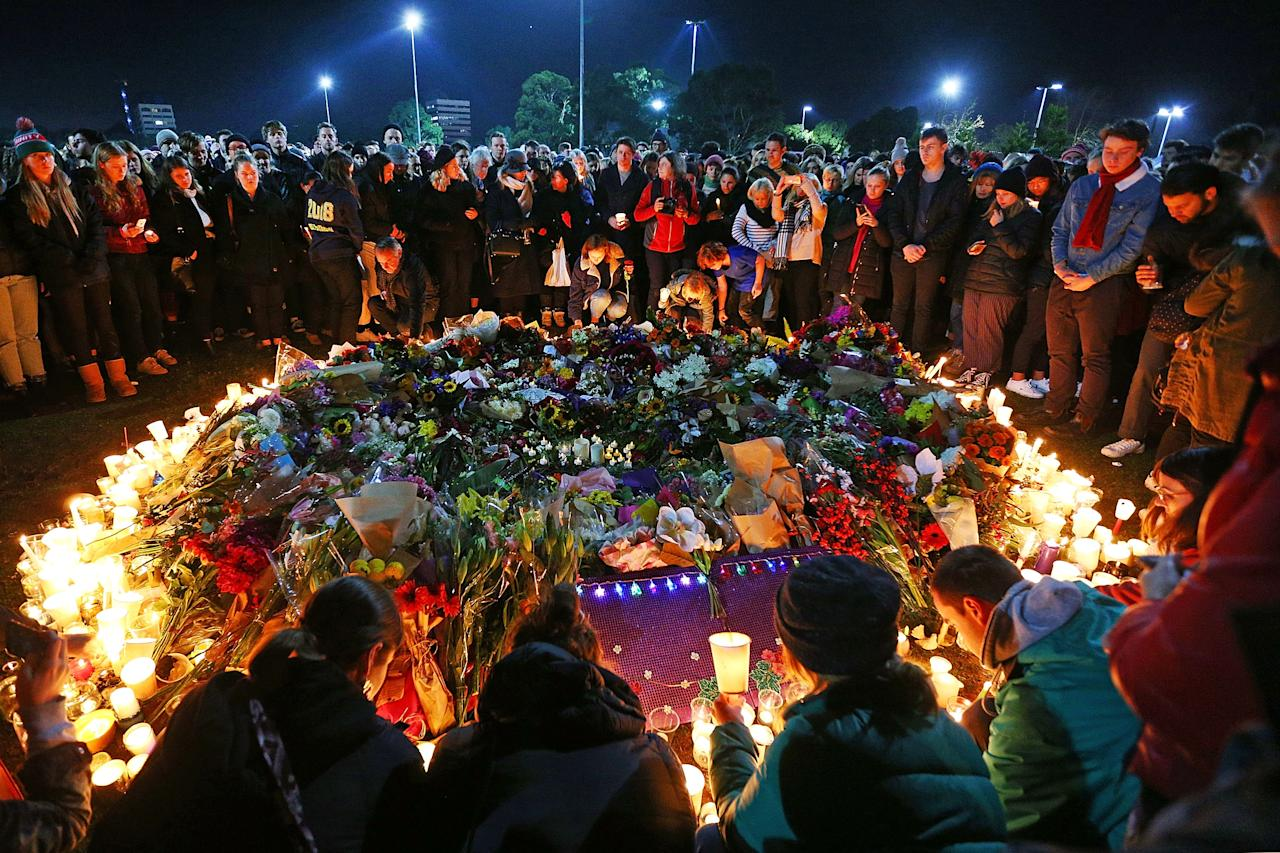 <p>Mourners pay their respects during a vigil held in memory of murdered Melbourne comedian, 22-year-old Eurydice Dixon, at Princess Park in Melbourne, Australia. Dixon was murdered as she walked home through Princes Park on Wednesday following a comedy performance in the city. (Michael Dodge/Getty Images) </p>