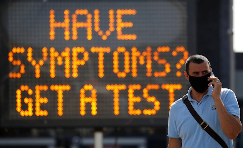A man walk past an information board following the outbreak of coronavirus in Bolton. (Photo: Phil Noble / reuters)