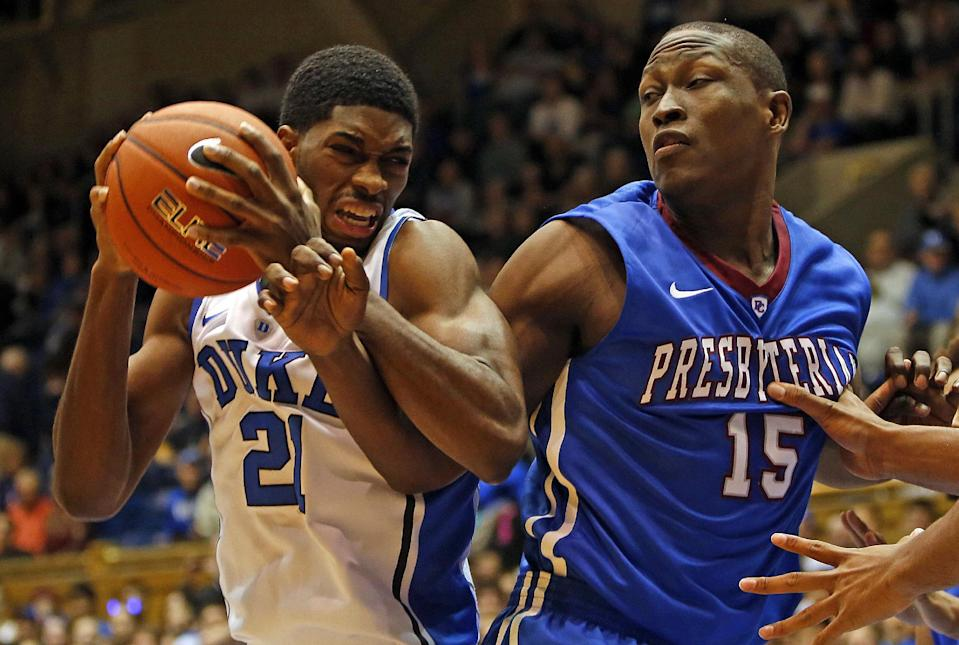 Duke's Amile Jefferson (21) battles with Presbyterian's William Truss (15) during the first half of an NCAA college basketball game in Durham, N.C., Friday, Nov. 14, 2014. (AP Photo/Karl B DeBlaker)