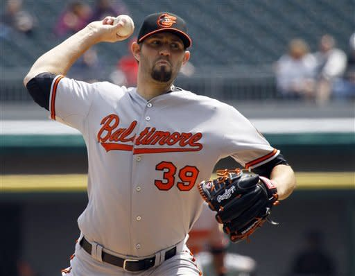 Baltimore Orioles starting pitcher Jason Hammel delivers during the first inning of a baseball game against the Chicago White Sox, Thursday, April 19, 2012, in Chicago. (AP Photo/Charles Rex Arbogast)