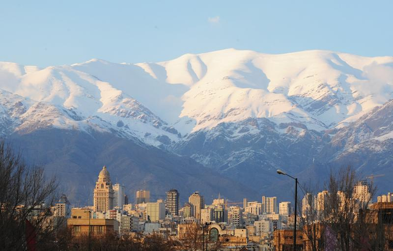 Iran's capital Tehran sits in the shadow of the Alborz mountains - 2016 Scott Peterson