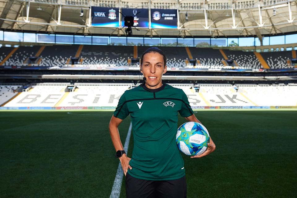 ISTANBUL, TURKEY - AUGUST 13: Main referee Stephanie Frappart of France poses with the official match ball before a training session ahead of UEFA Super Cup Final at Besiktas Park on August 13, 2019 in Istanbul, Turkey. (Photo by Alex Caparros - UEFA/UEFA via Getty Images)