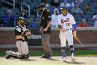 New York Mets' Francisco Lindor (12) reacts after he is intentionally walked to load the bases during the ninth inning of a baseball game against the Miami Marlins, Thursday, April 8, 2021, in New York. (AP Photo/John Minchillo)
