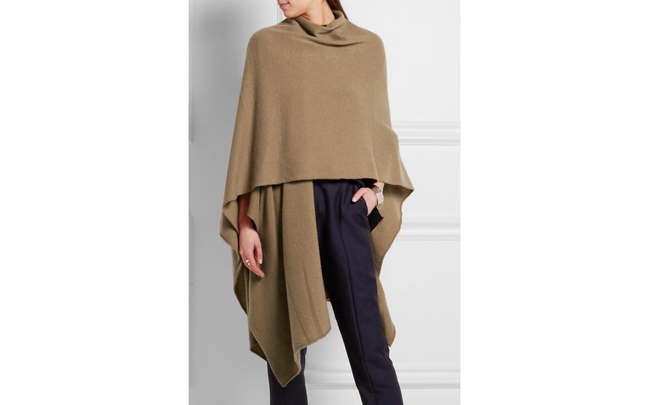 """<p>Thick and cozy cashmere gives this wrap a blanket-like quality. Snuggle up on the couch when it's cold outside, or wrap yourself up for a long day of travel ahead.</p> <p>To buy: <a href=""""https://click.linksynergy.com/deeplink?id=93xLBvPhAeE&mid=24449&murl=https%3A%2F%2Fwww.net-a-porter.com%2Fus%2Fen%2Fproduct%2F543003&u1=TL%2CStayCozyWithOur14FavoriteTravelWraps%2Cspearmac%2CTRA%2CGAL%2C461609%2C201910%2CI"""" target=""""_blank"""">net-a-porter.com</a>, $437</p>"""
