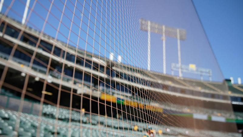 Why A's players don't mind trade-offs with extended protective netting