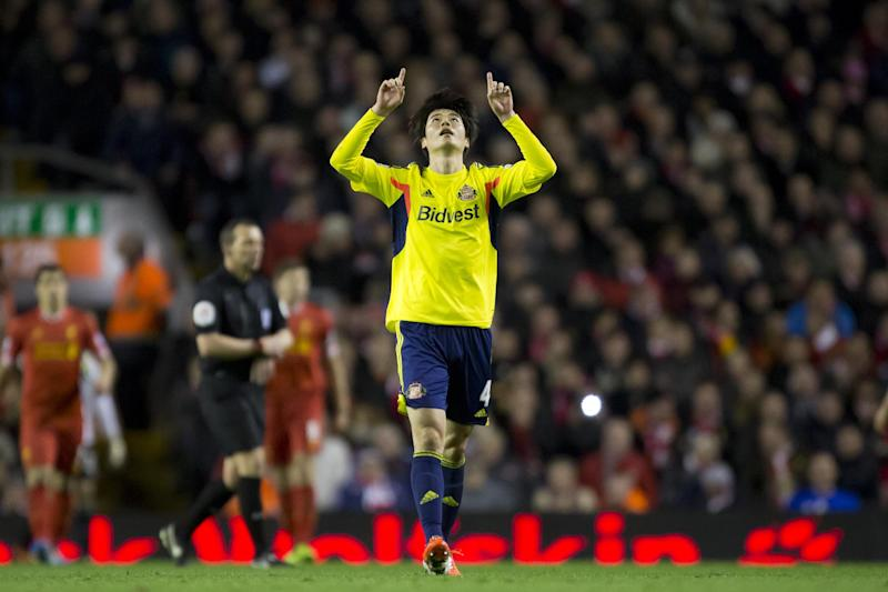 Sunderland's Ki Sung-Yueng celebrates after scoring against Liverpool during their English Premier League soccer match at Anfield Stadium, Liverpool, England, Wednesday, March 26, 2014. (AP Photo/Jon Super)